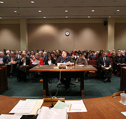 Lincoln Sen. Kathy Campbell introduces LB577 before a full hearing room Feb. 28.