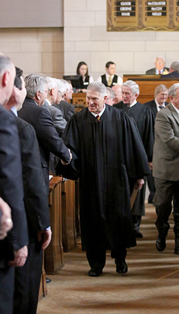 Chief Justice Michael Heavican of the Nebraska Supreme Court greets senators after delivering his State of the Judiciary address Jan. 29.