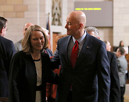 Gov. Pete Ricketts and First Lady Susanne Shore exit the Norris Chamber after Ricketts' State of the State Address Jan. 22.