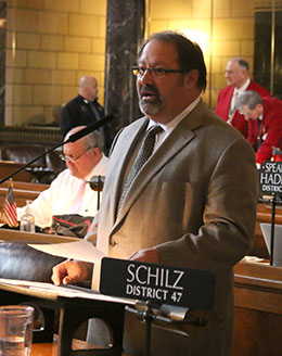 Image of Sen. Ken Schilz said LB176 would not obligate a producer to sign a contract with a packer.