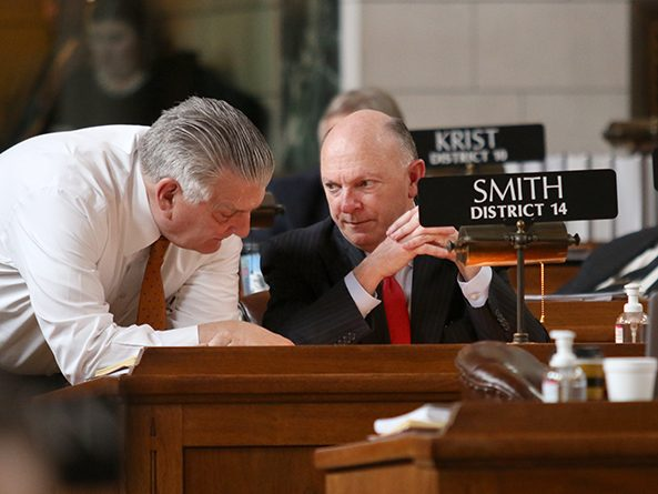 Revenue Committee chairperson Sen. Jim Smith (right), sponsor of LB461, confers with Sen. John Stinner, Appropriations Committee chairperson, during floor debate April 21.