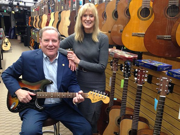 Above: Sen. Mike Moser with his wife Jan in their Columbus music store.