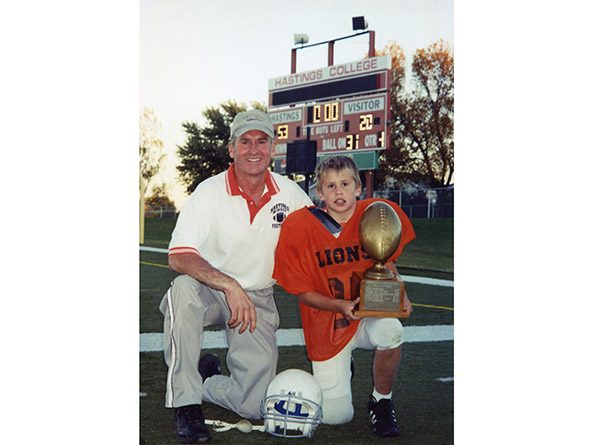 Sen. Dave Murman and his son Chase after winning a football championship in 2003.